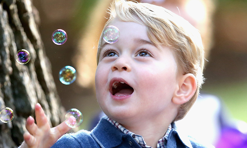 Little George was under a bubble spell during a children's party at Victoria's Government House on the seventh day of the Cambridge's royal tour of Canada. 