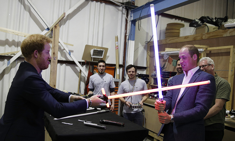 There's nothing wrong with a little brotherly competition. Princes William and Harry faced off in a lightsaber fight during a visit to Pinewood Studios in Heath, England. 