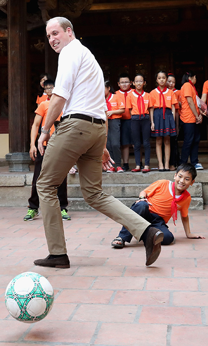 Bend it like William! During a visit to Vietnam, the father of two jumped in to play a game of soccer with children at Hong Ha Primary School. 