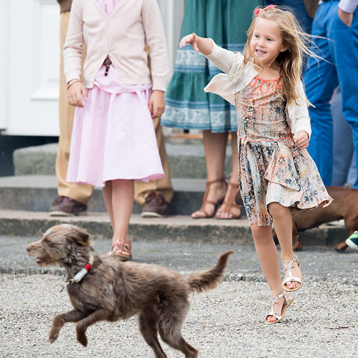 Princess Josephine of Denmark enjoyed a game of fetch with her pet pooch during a summer outing with her family. 