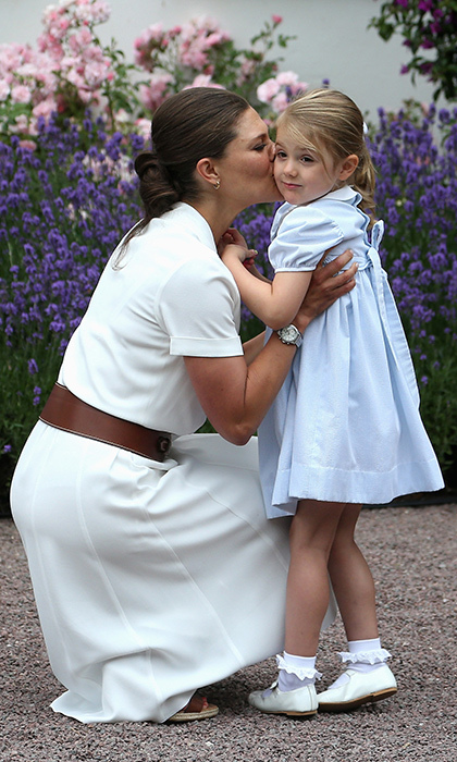 Princess Victoria of Sweden showered Princess Estelle with kisses during name day celebrations at Solliden Palace in July. 
