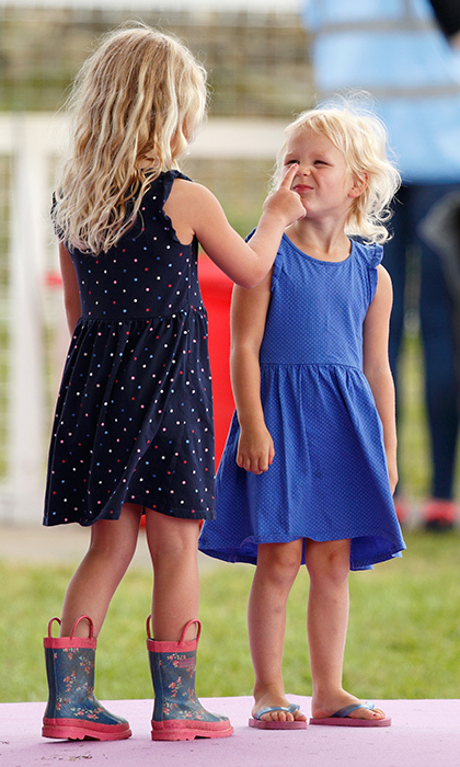 The Queen's great-granddaughters Savannah and Isla Phillips goofed around on day one of the Festival of British Eventing at Gatcombe Park. 
