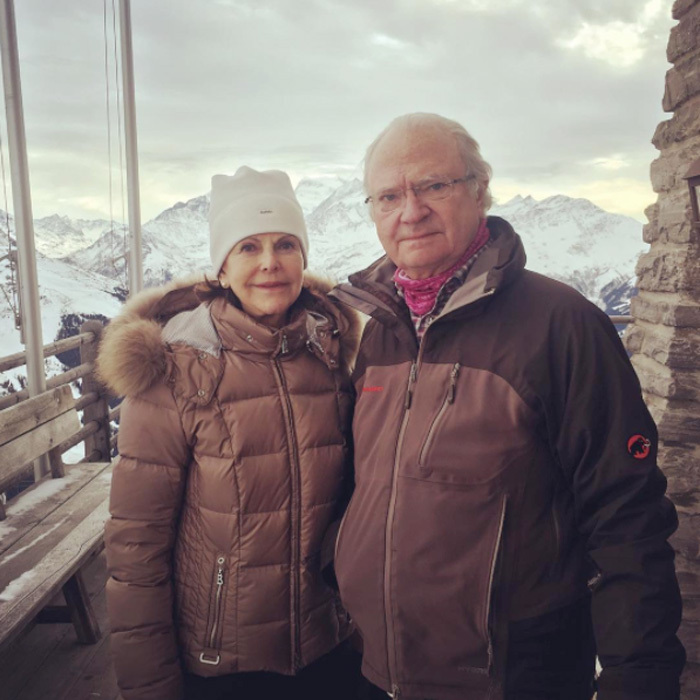 Queen Silvia and King Carl XVI Gustaf were coordinating in brown outerwear for their hike in the Swiss Alps. 