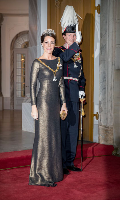 Princess Marie of Denmark, arriving with her husband Joachim, stunned in a metallic number at the annual reception. 