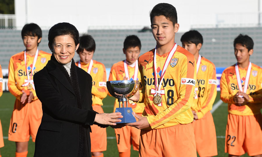 Princess Hisako Takamado of Japan posed with captain Riyo Kawamoto of the Shimizu S-Pulse soccer team after the Prince Takamado Trophy All Japan Youth (U-15) Football Tournament final match in Tokyo. Photo: © Getty Images