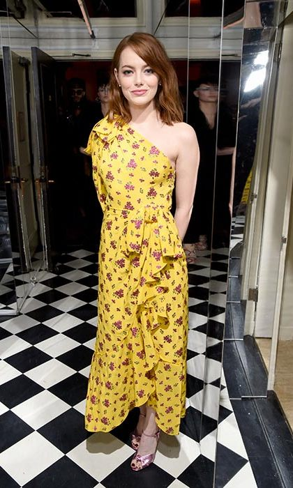Jan. 5: Emma Stone looked bold and beautiful in this yellow floral midi at W's pre-Golden Globes bash. 