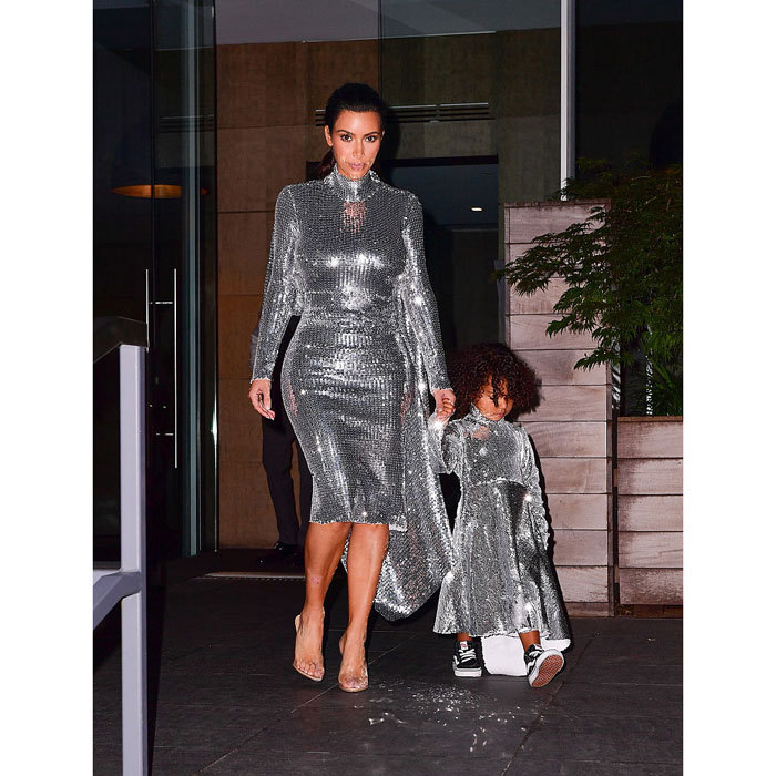 "<h3><a href=""/tags/0/kim-kardashian/"" target=""_blank"">Kim Kardashian</a> and North West</h3><p>Big city, bright lights — and dresses! The fashionable mother-daughter duo stepped out for Kanye West's concert at New York's Madison Square Garden wearing matching silver sequined dresses by Vetements. The reality star completed her look with heels, while the stylish toddler opted for black hi-tops.</p><p>Photo: © Getty Images</p>"