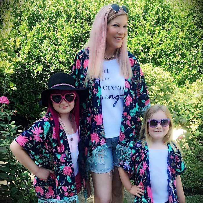 "<h3><a href=""/tags/0/tori-spelling/"" target=""_blank"">Tori Spelling</a>, Stella and Hattie McDermott</h3><p>Flower power! The actress and her daughters channeled their inner hippies wearing vibrant print kimonos from Haberdash Soul Company, paired with groovy shades and shorts.</p><p>Photo: © Instagram</p>"