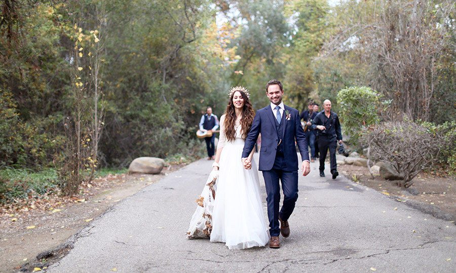 Just Married! The happy couple take their first stroll as husband and wife. <br><p>Photo: © Max Wanger