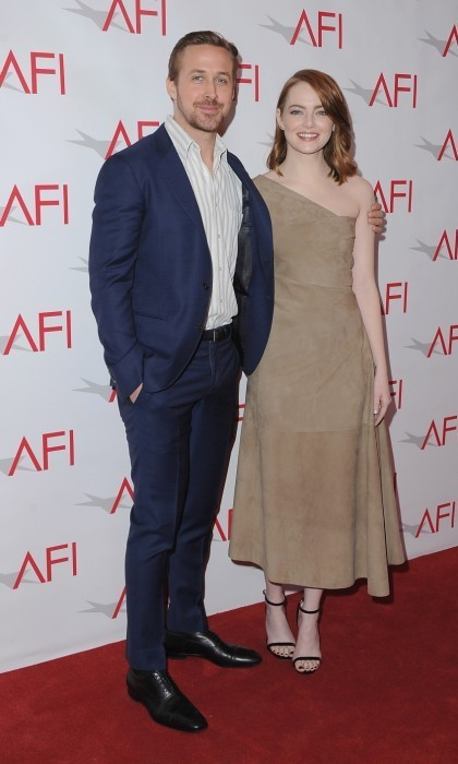 Jan. 6: Ryan Gosling and Emma Stone arrived at the 17th Annual AFI Awards luncheon at the Four Seasons Hotel in Beverly Hills. The co-stars looked ready to support their acclaimed film,<em>La La Land</em>, with Emma wearing a very unique suede dress by The Row.