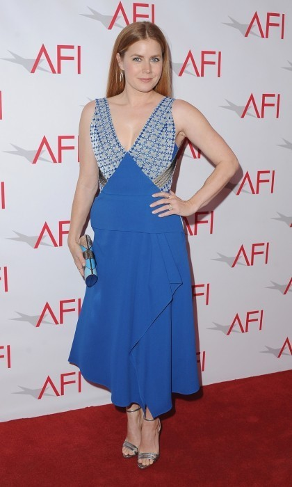 Jan. 6: Amy Adams rocked the red carpet in a Roland Mouret dress at the 17th Annual AFI Awards luncheon. The star, who also wore Neil J. Rodgers heels, Jennifer Meyer jewelry, and a Salvatore Ferragamo clutch, was there to celebrate her film <em>Arrival</em>.