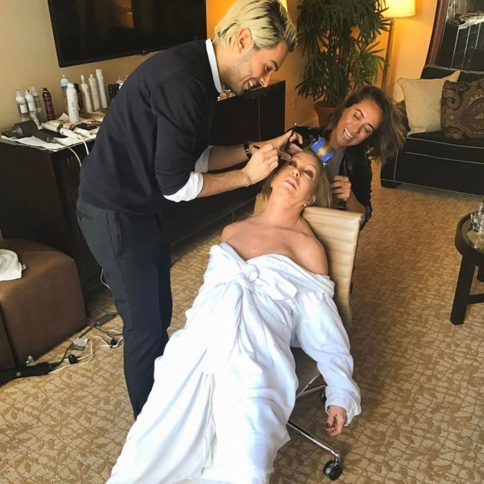 "Goldie Hawn multi-tasked as she fit in a power nap while getting ""globed"" by her glam team. 
