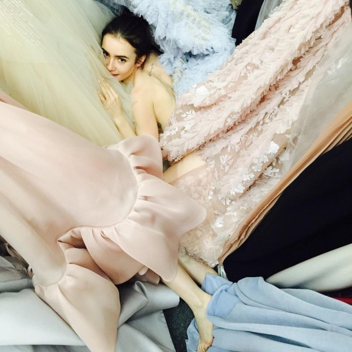 Lily Collins looked dreamy as she laid amongst a collection of dresses. The star teased her Golden Globes appearance when she posted the photo to her Instagram. 