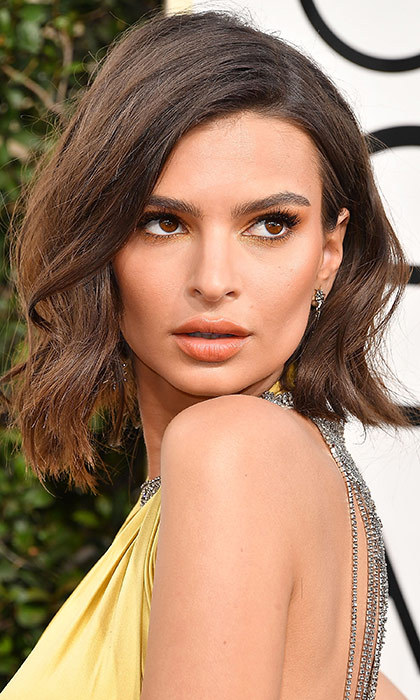 <h3>Emily Ratajkowski</h3><p>Pretty sure this was her usual length pinned up, but if we were Emily's bff, we'd tell her to go for the chop.</p><p>Photo: © Getty Images</p>