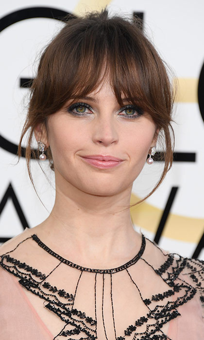 <h3>Felicity Jones</h3><p>A soft, wispy bun and piece-y bangs come together to make a more red carpet-approps version of her character's 'do in <em>Rogue One</em>.</p></p>Photo: &copy; Getty Images</p>