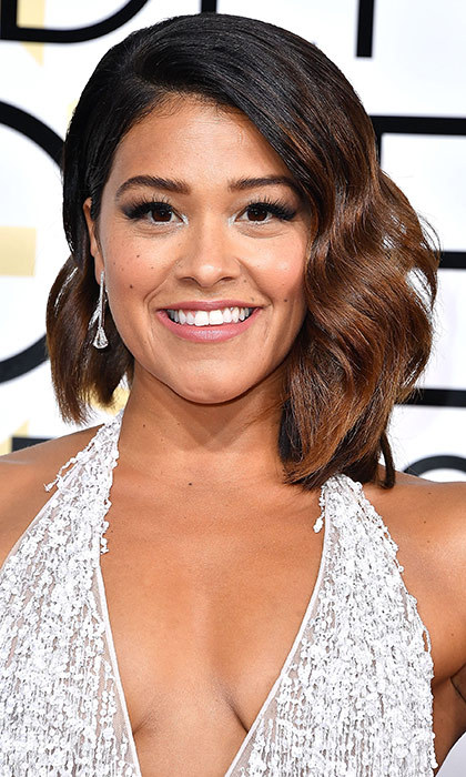 <h3>Gina Rodriguez</h3><p>Gina's asymmetrical bob gives her a hit of edginess, and the subdued makeup lets us focus on its face-framing glory.</p></p>Photo: &copy; Getty Images</p>