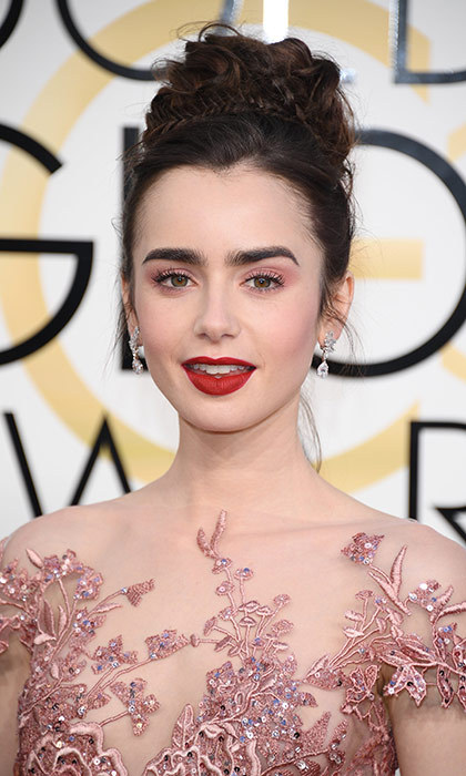 <h3>Lily Collins</h3><p>Lily has the face of a princess, so why not match it with big, braided, intricate princess bun? This is a look that will inspire hundreds of prom 'dos, and we're not mad.</p><p>Photo: © Getty Images</p>