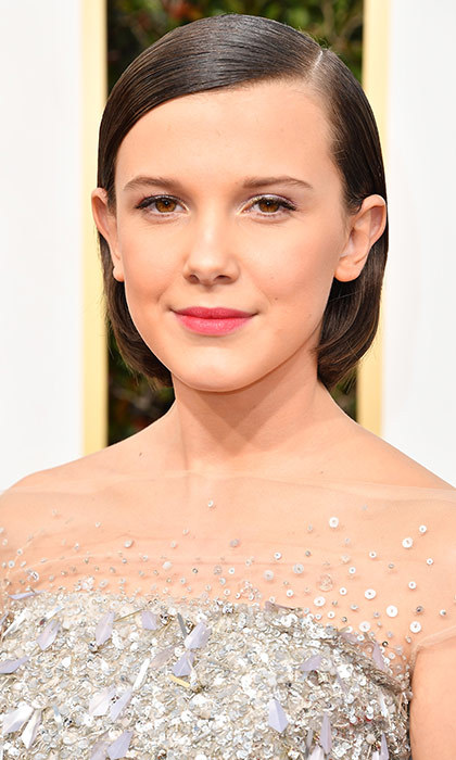 <h3>Millie Bobby Brown</h3><p>Growing out that <em>Stranger Things</em> Eleven buzz suits 12-year-old Millie, and the pop of pink on her lips kept her look youthful and fun.</p><p>Photo: © Getty Images</p>
