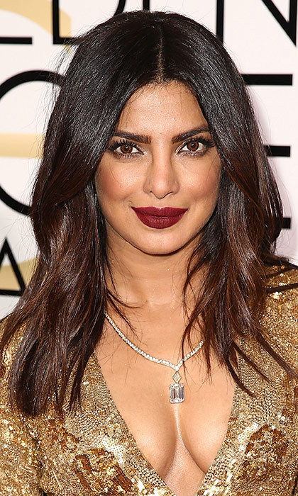 <h3>Priyanka Chopra</h3><p>Simple, soft waves and a deep, burgundy lip is our new favourite beauty look for this former <em>FLARE</em> cover star.</p><p>Photo: &copy; Getty Images</p>