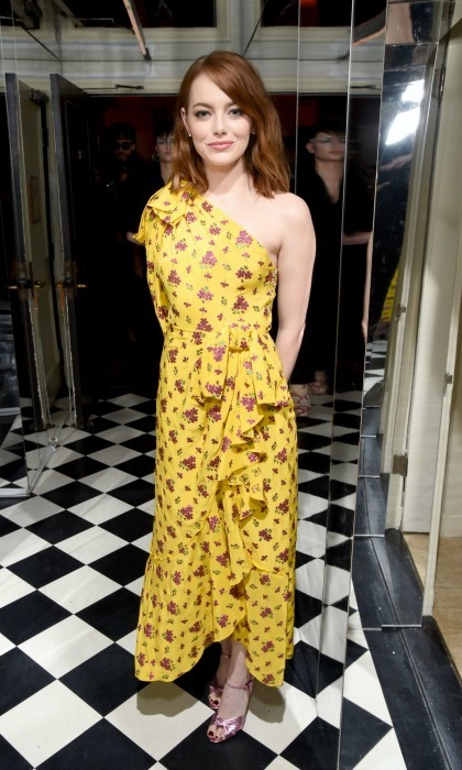 <strong>January 5:</strong> So not mellow yellow! Emma Stone struck a pose during the <em>W Magazine</em> party celebrating the Best Performances Portfolio and the Golden Globes with Audi and Moet & Chandon at Chateau Marmont in L.A.