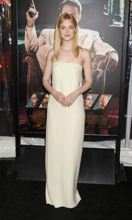 Jan. 9: Elle Fanning looked effortlessly elegant wearing a cream gown by Oscar de la Renta to the Hollywood premiere of <em>Live by Night</em>. 