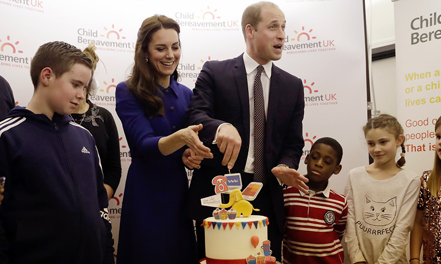 The royals cut a cake to celebrate the centre's first anniversary.