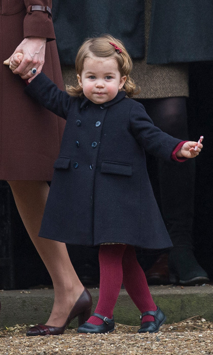 Princess Charlotte is already taking after her stylish mom. The royal tot looked adorable for Christmas church service with her family donning a double-breasted coat, ribbed knit tights, Mary Jane flats and an Amaia Kids hair bow.
