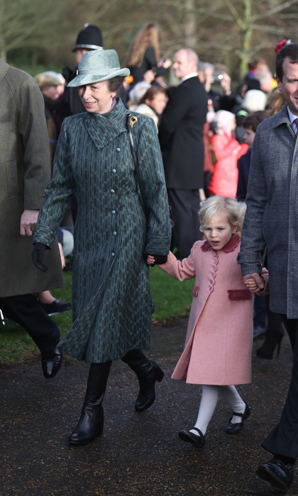 Princess Anne looked anything but blue stepping out in a printed teal coat and matching hat with her granddaughter Isla Phillips (dressed in pink) for Christmas Day church service at Sandringham.