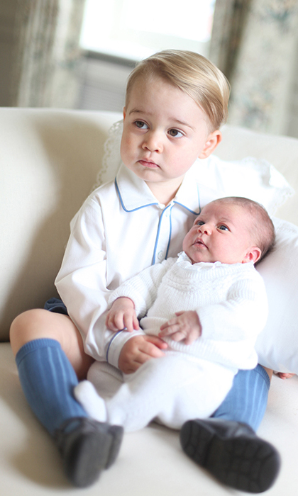 In 2015, Kate became the first member of the royal family to take the first official photographs of a royal baby, with the Duchess releasing her own images of newborn Charlotte being held by her big brother George at the family home, Anmer Hall, in Norfolk.