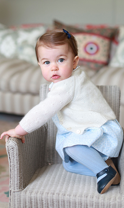<p>The doting mum again treated fans to a set of portraits in May 2016, to celebrate Princess Charlotte's first birthday.</p><p>Photo: © Rex</p>