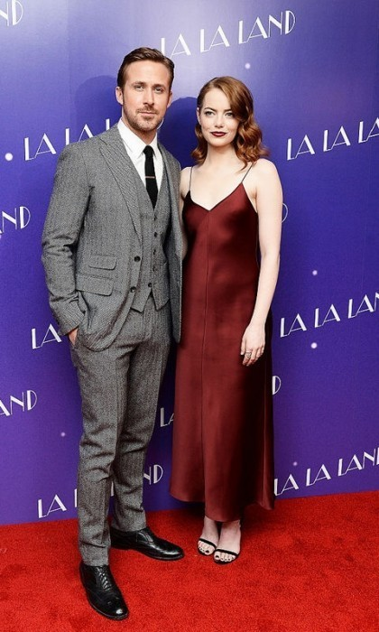 <strong>Jan. 12:</strong> Emma Stone matched her darker hair shade to her bordeaux satin slip dress by The Row with Ryan Gosling during the London screening of <em>La La Land</em>.