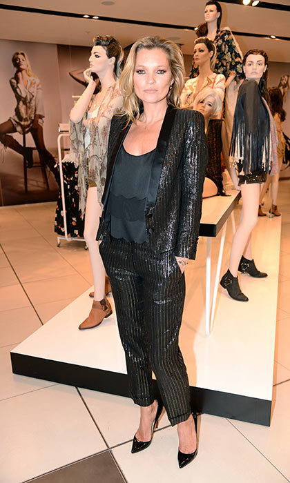 <h3>8. Go for glitter</h3><p>A little bit of sparkle, shimmer and shine is fun and youthful, and that's never a bad idea in Kate's books. She wore this black-and-gold pinstripe stunner to her Kate Moss x Topshop launch party in 2014.</p><p>Photo: &copy; Shutterstock</p>