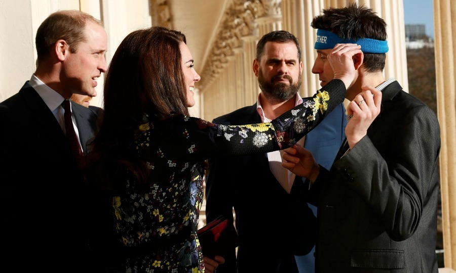 This time around, William, Kate and Harry opted not to wear the Heads Together headbands, but that didn't stop Kate from helping attendee Jon Salmon with his.