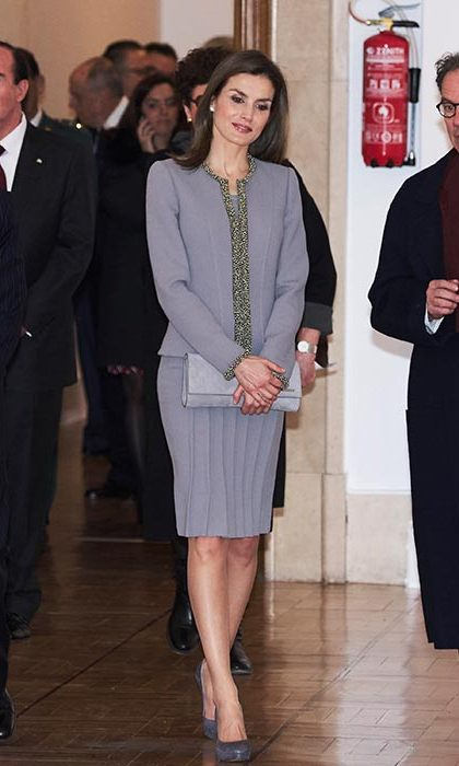 Queen Letizia looked sophisticated in a grey skirt suit with an embellished trim for an engagement in Madrid on Jan. 20.
