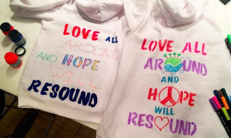Sarah Rafferty showed off powerful and inspiring hoodies her daughter created for today's marches. 