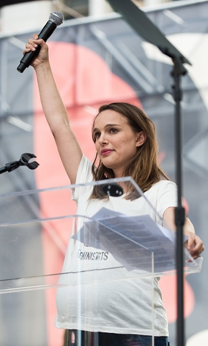 Natalie Portman addressed a rally in Los Angeles sporting a 'We Should All Be Feminists' t-shirt.