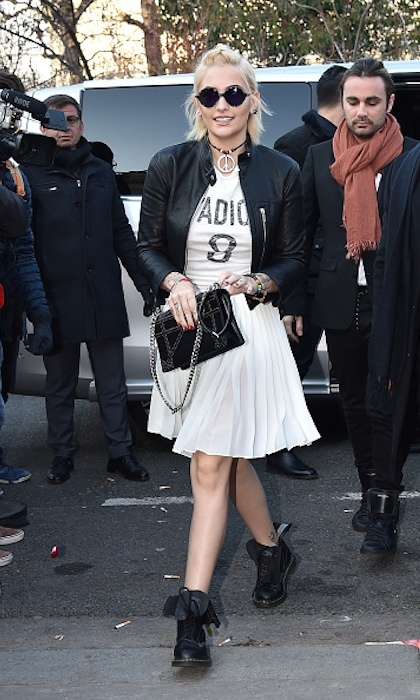 <strong>January 21:</strong> Fresh off of her Parisian photo shoot, Paris Jackson slipped into some Dior to attend the fashion house's menswear fall/winter 2017 show at Paris Fashion Week. 