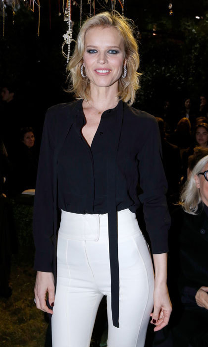 Eva Herzigova donned high-waist white trousers and a black blouse to the Christian Dior Haute Couture show.