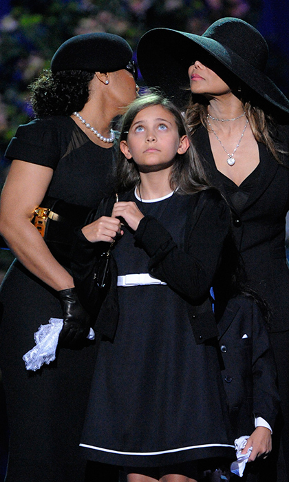 Paris at her father's funeral in 2009. 
