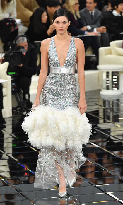 Kendall Jenner shimmered on the runway in a plunging silver dress at the Chanel Spring Summer 2017 show.