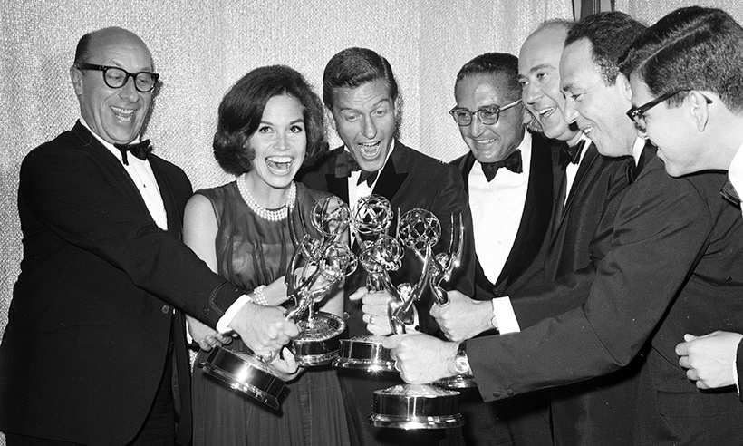 In this throwback photo, Mary poses alongside her <em>The Dick van Dyke Show</em> co-stars after they accepted an Emmy for their work on the hit program.  