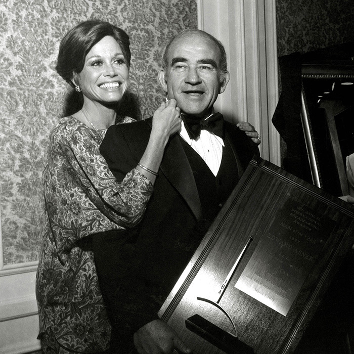 A sartorial star, Mary posed alongside Ed Asner in a bold paisley frock at the Radio and Television Society Awards.