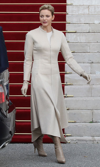 Princess Charlene of Monaco was the picture of elegance leaving the Monaco Cathedral during the Sainte-Devote festivities wearing a sandstone-coloured coat, which she paired with matching boots and gloves.