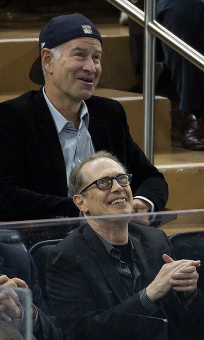Tennis ace John McEnroe and actor Steve Buscemi watched the New York Rangers take on the Pittsburgh Penuins at Madison Square Garden on April 19, 2016.