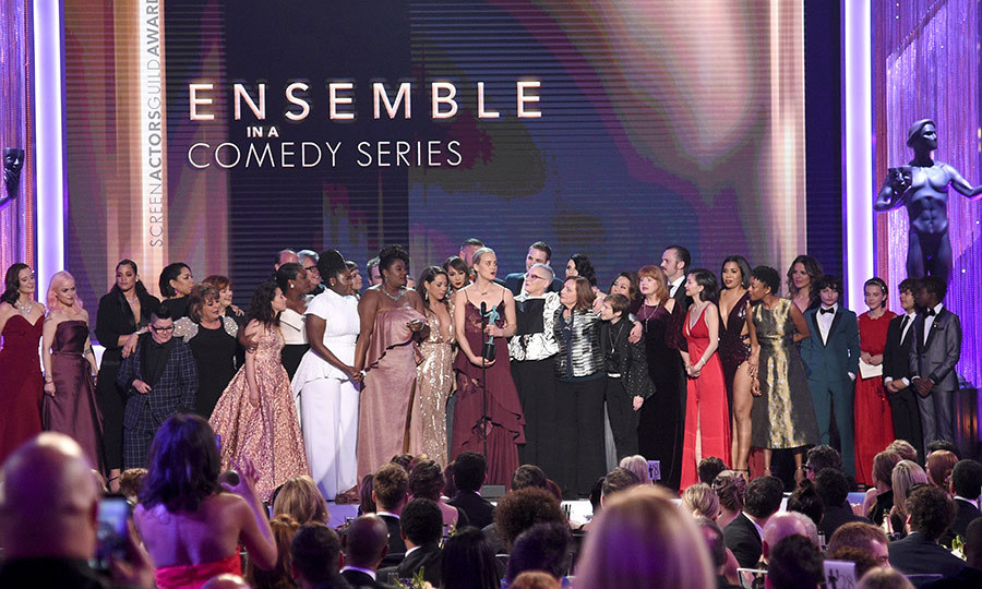 The cast of <em>Orange is the New Black</em> highlighted the many nationalities that make up their diverse cast as they took to the stage to receive the best comedy ensemble award