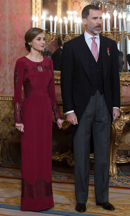 Letizia stunned in a red gown to greet foreign ambassadors.