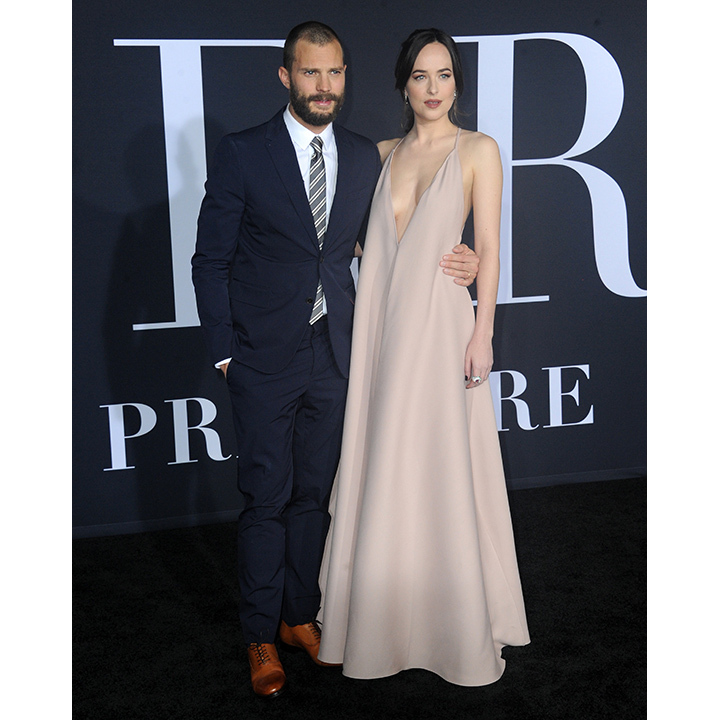 <strong>Feb. 2:</strong> Dakota Johnson slipped into a light and airy creation from Valentino's spring collection for the premiere of <em>Fifty Shades Darker</em> in Los Angles. Her co-star Jamie Dornan looked equally as charming in a navy suit. 