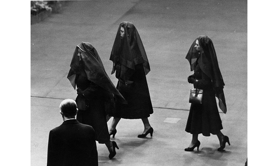 Elizabeth, now Queen, pictured at her father's funeral with her mother and sister, Princess Margaret.