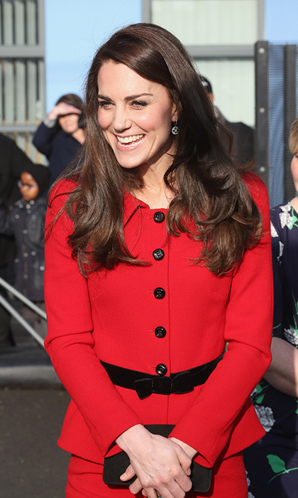 Kate looked radiant in a red Luisa Spagnoli suit during her Place2Be visit.