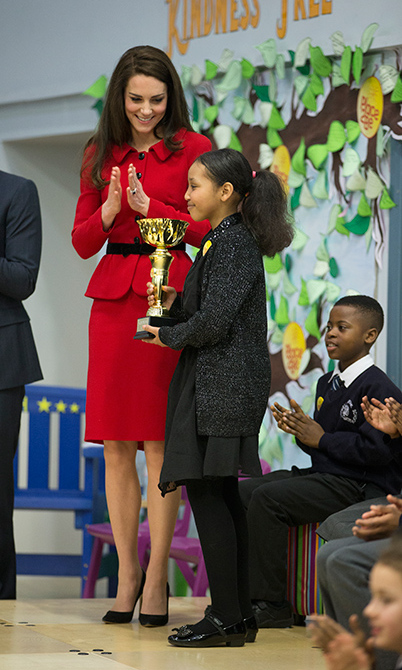 "Duchess Kate presented Nadia Dhicis with the first ""Kindness Cup"".